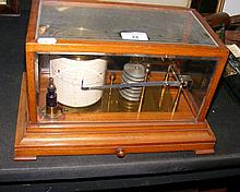 An old barograph in mahogany case with chart