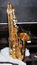 An as new saxophone by J Michael in fitted