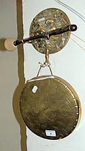 A decorative brass dinner gong