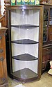 A bow fronted glass corner display cabinet
