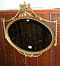 An Adams style oval wall mirror