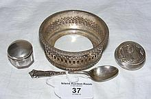 A silver wine coaster, tea spoon, etc