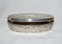 A decoratively chased and engraved 10cm oval
