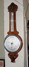 A wheel barometer/thermometer by Messenger of