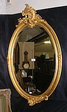 An attractive old gilt framed oval wall mirror