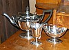A three piece silver teaset of elegant design,