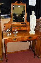 An Edwardian dressing table with drawer to the