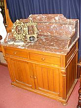 A Victorian rouge marble washstand with drawers