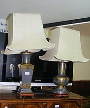An oriental metal table lamp and one other