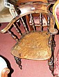 An old beech and elm smoker's bow armchair with