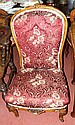 A Victorian nursing chair with carved cabriole