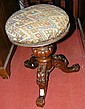 A Victorian rosewood piano stool with padded seat