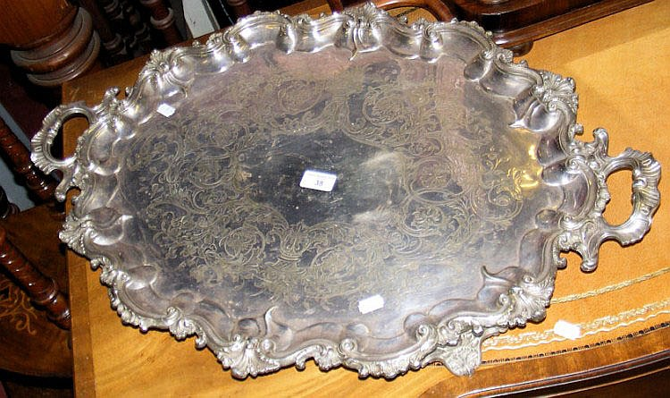 A large silver plated two handled serving tray