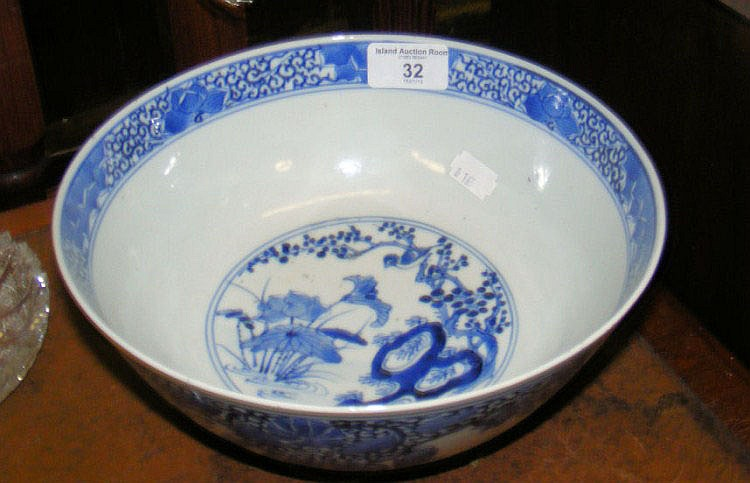 An antique Chinese blue and white bowl with four