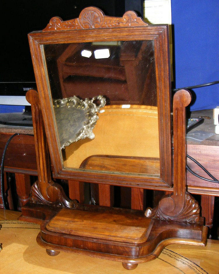 An Edwardian mahogany toilet mirror with carved