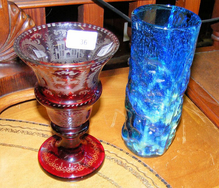 An 18cm Bohemian red overlaid glass goblet shaped
