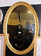A 101cm x 72cm oval hanging wall mirror in