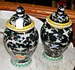 A pair of oriental baluster vases and covers with