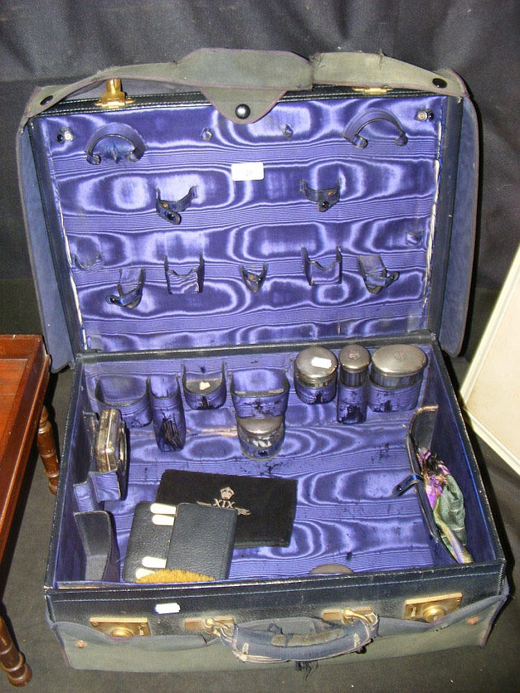 An Edwardian blue leather gentleman's travelling