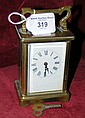 A brass cased carriage clock
