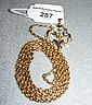 An Edwardian 9ct gold pendant on yellow metal
