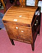 A domed top Regency mahogany cellaret with ivory