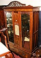 An Edwardian walnut wardrobe with bevelled