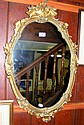 A decorative gilt wall mirror - 78cm