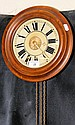 A 27cm diameter mahogany cased wall clock with