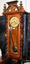 A Vienna style antique wall clock with striking movement
