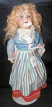An old Armand Marseille bisque head doll with rolling glass eyes, open mout