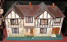 A large double fronted TRI-ANG Stockbroker dolls house in the Tudor style -