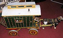 An unusually large old model child's Gypsy caravan with wooden horse, havin