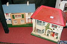An old metal and wood TRI-ANG dolls house with fitted vintage furniture wit