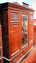 Large Edwardian mahogany triple robe, central mirrored panelled door flanke