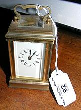 A miniature brass cased carriage clock - 9cm high
