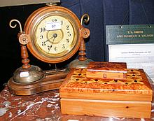 An unusual striking mantel clock, together with two wooden boxes