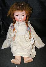 An old Armand Marseille bisque head doll with composite body, rolling eyes