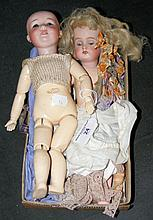 An old Armand Marseille bisque head baby doll with glass eyes and open mout
