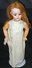 An old Simon and Halbig bisque head doll with glass eyes, open mouth and pi