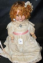 An old Armand Marseille bisque head doll with rolling glass eyes and open m
