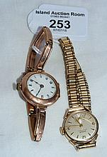 A lady's gold cased wristwatch and one other