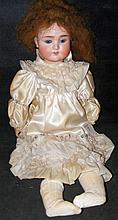 An old German bisque head doll with rolling eyes and open mouth, having com