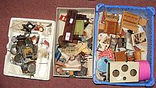 Three boxes containing vintage dolls house furniture, including tables, dre