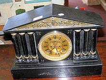 A Palladian style slate cased striking mantel clock with visible escapement