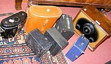 Boxed cameras, binoculars, radio receiver