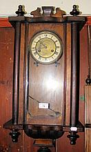 Hanging striking wall clock, together with a mantel clock