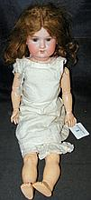 An old Armand Marseille bisque head doll with rolling eyes and open mouth,