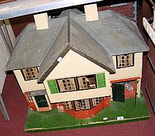 A 1940's style TRI-ANG dolls house with fully fitted vintage furniture - 77