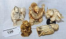 A carved ivory netsuke, together with four others